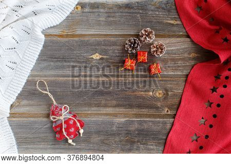 New Year Flat Lay: Christmas Linen Tree With Hearts, Red Tiny Gifts, Cones, White Woolen Plaid And R