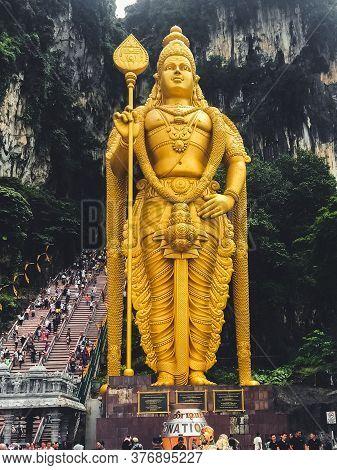 Kuala Lumpur, Malaysia - July 17, 2020: The Giant Statue Of Hindu God At The Batu Caves Temple.  The
