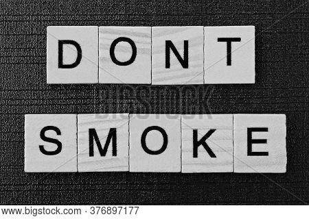 Phrase On Dont Smoke From Gray Wooden Letters On A Black Background