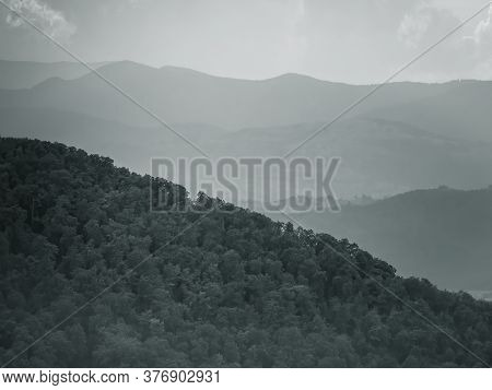 Hazy, Misty Mountain Or Hills Landscape. Beautiful View With A Cloudy Sky From Tampa Mountain, Braso