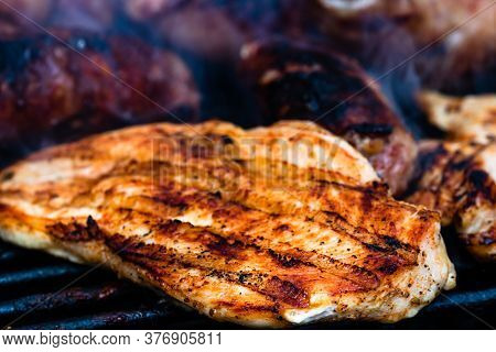 Close Up On Details Of Homemade Chicken, Pork Steak And Sausages On Barbecue Grill. Barbecue, Grill