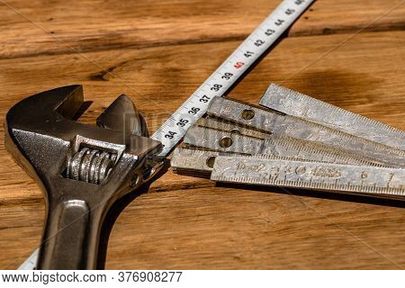 Tools For Repair And Building. Hummer, Adjustable Spanner, Ruler. Instruments On Rustic Wooden Table