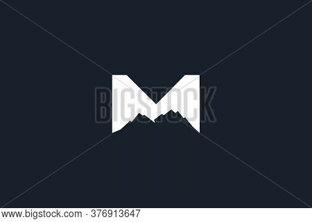 mountain logo design . Letter M for mountain logo design ideas . Mountains. Mountain logo vector. Mountain icon vector. Mountain icon. Mountains logo. Mountain logo template. Mountains logo design. Mountains emblem logo. Mountains logo vector illustration