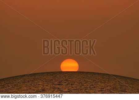 Beautiful Sunset - Large Bright Orange Sun Sets Over The Horizon Of The Black Sea, Crimea