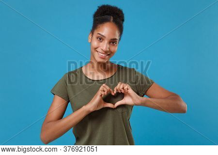 Smiling Young African American Woman Girl In Casual T-shirt Posing Isolated On Blue Background In St