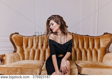 Young, Eccentric, Interesting Girl 25 Years Old, Sitting On Large Royal Chair And Posing In Front Of