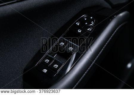 Novosibirsk/ Russia - April 28 2020: Mazda 3, Closeup Of A Door Control Panel In A New Car. Arm Rest