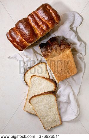 Homemade Hokkaido Wheat Toast Bread Whole And Sliced On White Cloth On White Texture Background. Fla