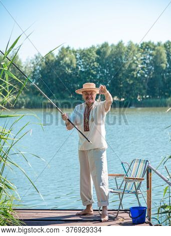 Senior Man On A Fishing, Lifestyle Of People On Retired. Hobby Of Older People