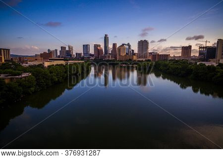 Sunrise On Lady Bird Lake Of Austin Texas A Mirrored Image Of A Calm Morning Sunrise On Town Lake Or