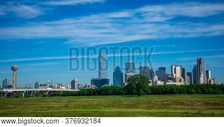 Sunny Afternoon In Dallas Texas Green Grass And Blue Sky During Bright Sunny Day With Downtown Skyli