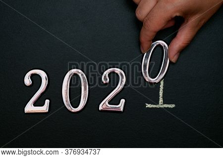 Hand Changes The Year 2020 To 2021. New Year, Business And Planning Cover Page Concept