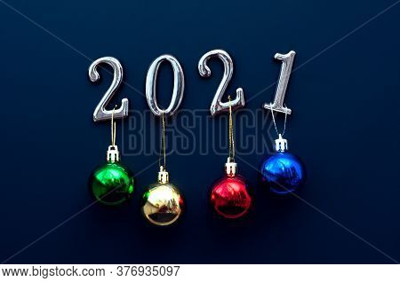 Silver Numbers 2021 With Colorful Balls On A Blue Background With Decorations. New Year Concept, Mer