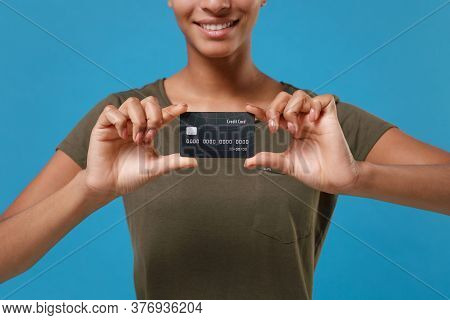 Cropped Image Of Young African American Woman Girl In Casual T-shirt Posing Isolated On Bright Blue