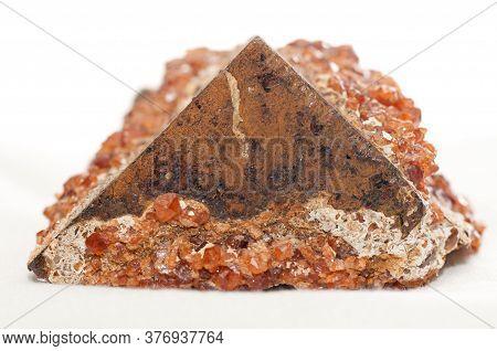 Garnet On Pyrite Crystal And Metal Samples