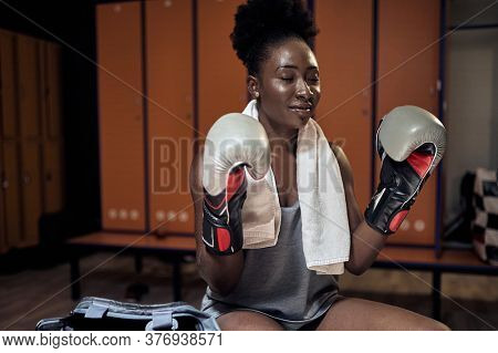 Woman with the boxing gloves.Sport boxing young girl.