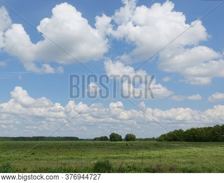 Clouds Running Across The Sky Over A Field On A Summer Day
