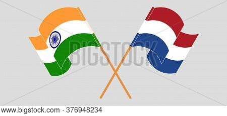Crossed And Waving Flags Of India And Netherlands. Vector Illustration