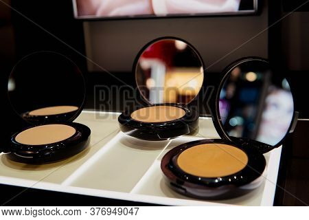 Compact Face Powder Makeup In Black Case With Mirror On Shelf In The Shop. Beauty, Cosmetic, Make Up