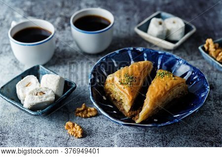 Turkish Delight. Baklava And Coconut Lukum With Cups Of Coffee