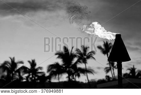Tiki Torch Burning In Hawaii In Black And White With Room For Your Type.