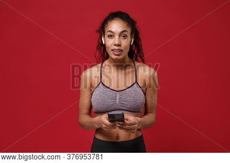 Confident Young African American Sports Fitness Woman In Sportswear Posing Work Out Isolated On Red