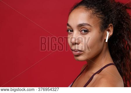 Side View Close Up Of African American Sports Fitness Woman In Sportswear Working Out Isolated On Re