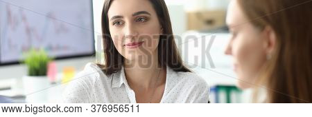 Portrait Of Businesswoman Sitting At Modern Workplace And Looking At Somebody With Concentration. Sm