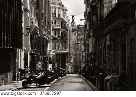 MADRID, SPAIN – MAY 13, 2018: Street view of small alley with historic buildings in Madrid, Spain.