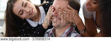 Portrait Of Close Friends Having Fun And Closing Eyes With Hands To Male Mate. Middle-aged Man Holdi