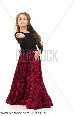 Full Length Portrait Of Beautiful Girl Wearing Black And Red Long Dress Dancing With Outstretched Ha