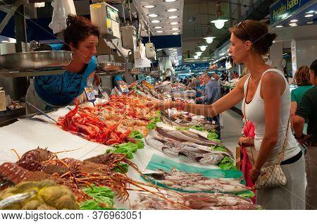 Palma De Mallorca, Balearic Islands/spain; July 2014: Woman Buying At A Fish Stall In The Mercado De