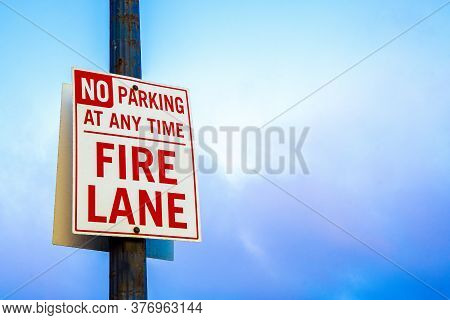 Fire Lane Sign. No Parking At Any Time. Outdoor Public Message Warning. Street Signage For Motorists