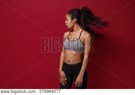 Beautiful Young African American Sports Fitness Woman In Sportswear Posing Working Out Isolated On R
