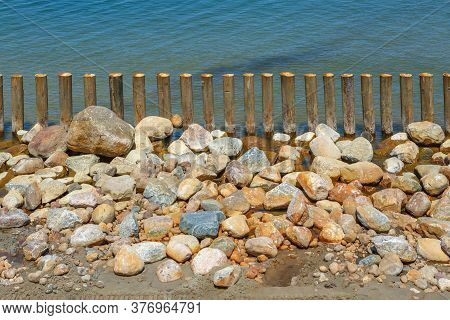 Large Rubble On The Seashore For The Construction Of Breakwaters