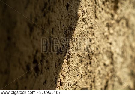 Light And Shadow On The Adobe Wall