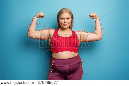 Determinated Girl Wants To Remove Fat And Does Gym At Home. Satisfied Expression. Cyan Background