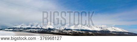 Tatra Mountains In Slovakia. Panorama Of The Mountain Range. Winter In The Mountains In Nature. Blue