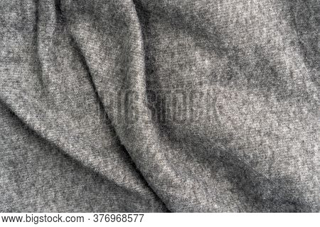 Crumpled Gray Woolen Fabric With Folds And Wrinkles. Close-up