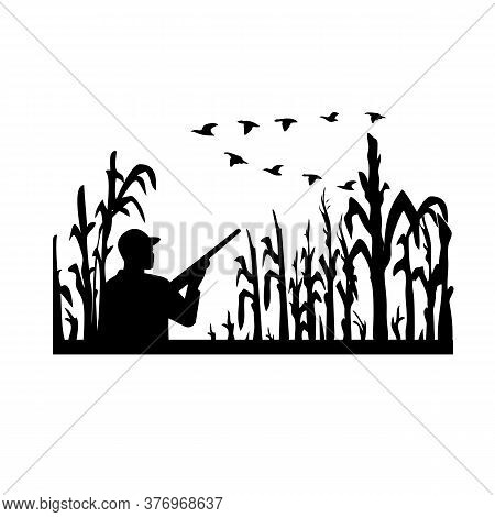 Retro Black And White Style Illustration Of A Silhouette Duck Or Bird Hunter With Rifle In Flooded C