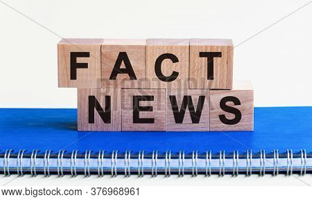 Wooden Cube With Flip Block Fact News Word On Table Background. News, Solution And Business Concepts