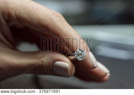 Diamond. Luxury Precious Gemstone In Jewelry Tweezers