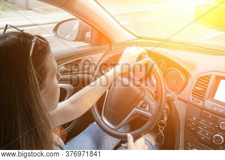 Business Woman Driving Car. Travel Car Trip On Road At Sunset. Happy Young Man Have Fun Ride Inside