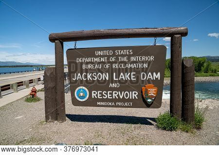 Grand Teton National Park, Wyoming - June 26, 2020: Sign For The Jackson Lake Dam And Reservior, Par