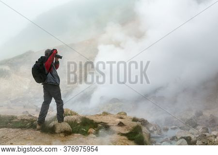Male Photographer Takes Pictures Of Mysterious Volcanic Landscape, Aggressive Hot Spring, Eruption F