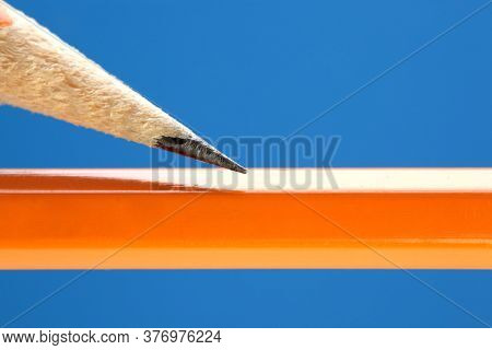 Close up of pencil tip with blank yellow pencil