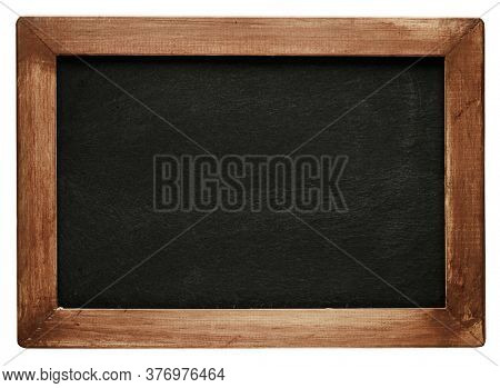 Old vintage chalkboard with worn wooden frame. Blank empty blackboard with space for text.