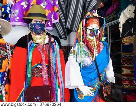 Mannequins Dressed In National Costumes Of Ecuador And Bolivia With Protective Masks During Pandemic