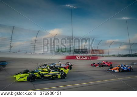 July 17, 2020 - Newton, Iowa, USA: CHARLIE KIMBALL (4) of the United States races through the turns during the  race for the Iowa INDYCAR 250s at Iowa Speedway in Newton, Iowa.