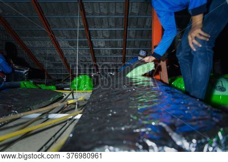 Bangkok, Thailand - January 19, 2020 : Unidentified Worker To Installing Thermal Insulation Or Heat